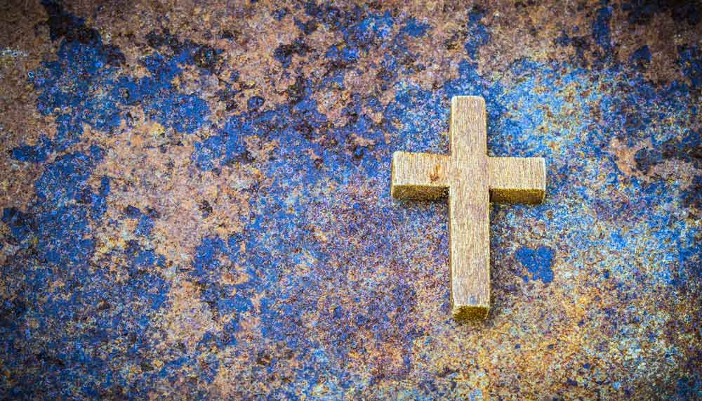 Kreuz auf blauem Untergrund